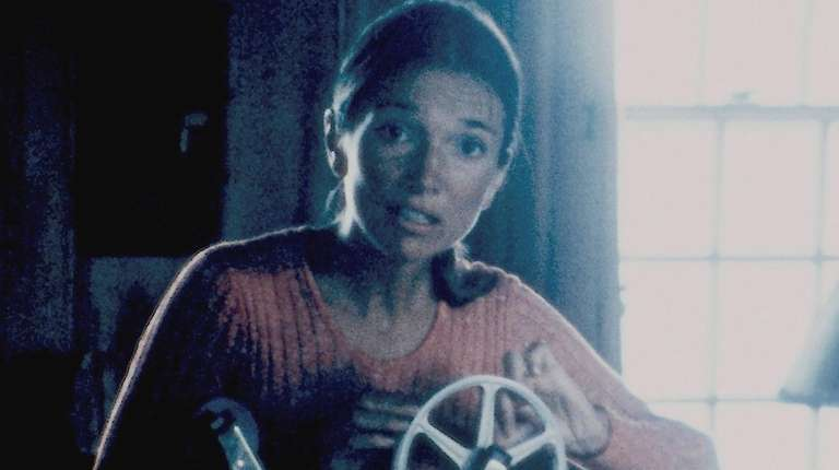 "Lee Radziwill threads a film projector in ""That"