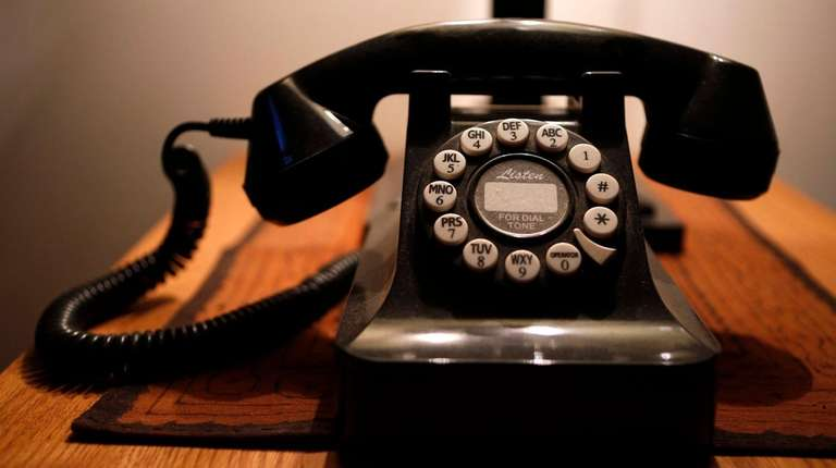 A push-button landline telephone.