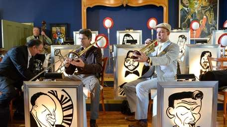 Ray Anderson, left, plays trombone with Tom Manuel