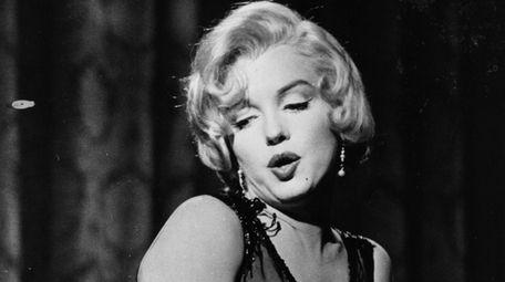 Marilyn Monroe between shots during the filming