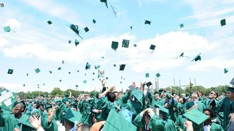 Brentwood High School students toss their hats in