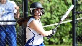 Portledge's Carly Klienwaks gets a hit during the