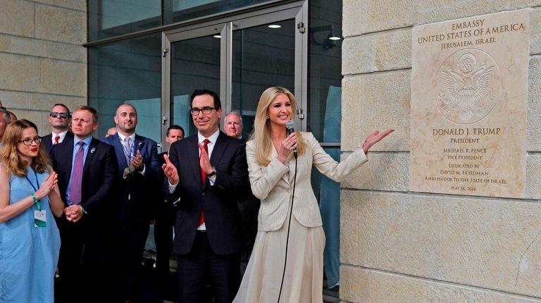 Treasury Secretary Steve Mnuchin applauds as Ivanka Trump,
