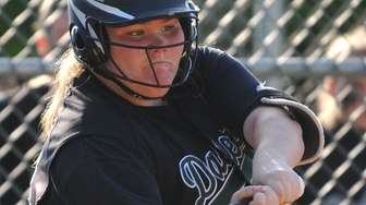 Christina Hassett, Farmingdale pitcher, connects for a two-run
