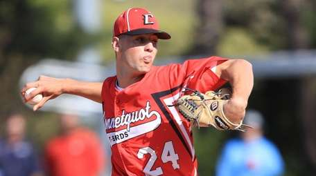 Connetquot's Joseph Savino delivers against Newfield in the