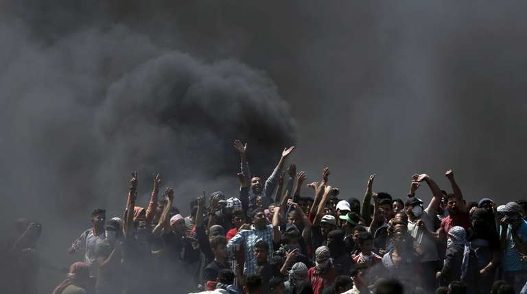 Palestinians protest Monday near the Gaza Strip's border
