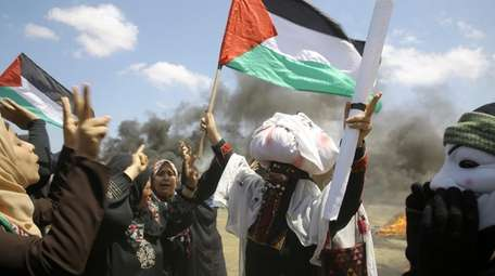 Palestinian women protest near the Israeli border in