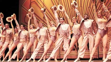 "The company of ""A Chorus Line"" performs the"