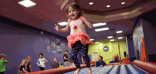 Rebecca Chustek, 3, of Smithtown, plays at Little