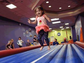 Rebecca Chustek, 3, of Smithtown, plays at Little