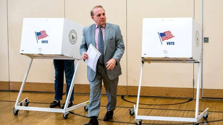 Denis Garbo, of Lindenhurst, votes at Lindenhurst's Harding