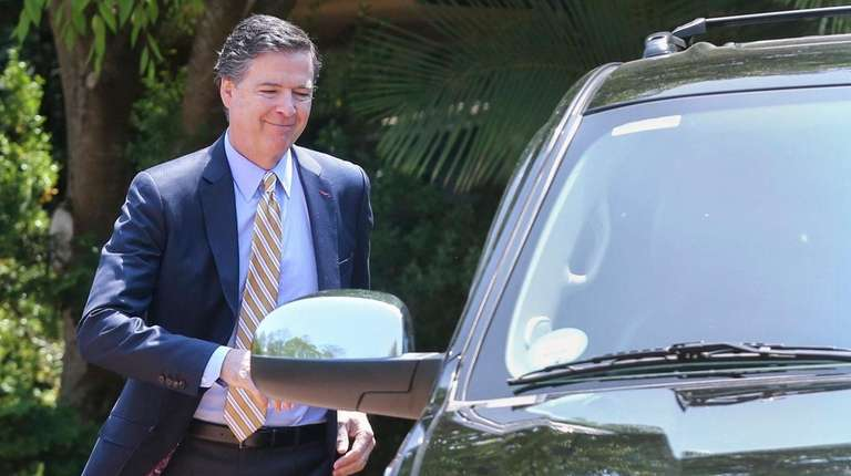 Former FBI Director James Comey leaves an LIA