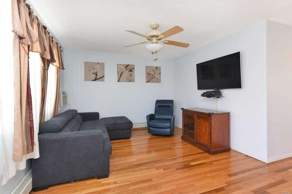The living room in this East Meadow Cape