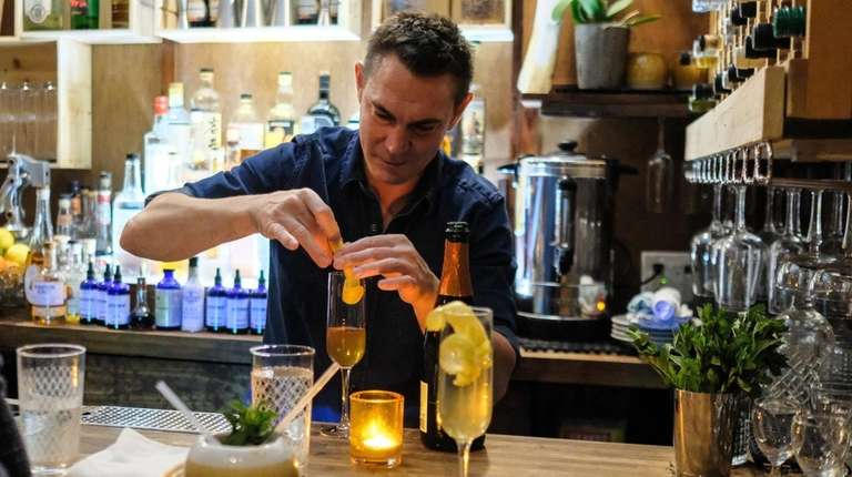 Steve Magliano mixes cocktails at Lost at Sea