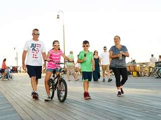 Strolling along the Long Beach boardwalk.