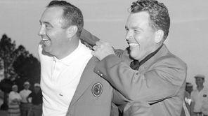 Doug Ford, left, gets assistance from Jack Burke