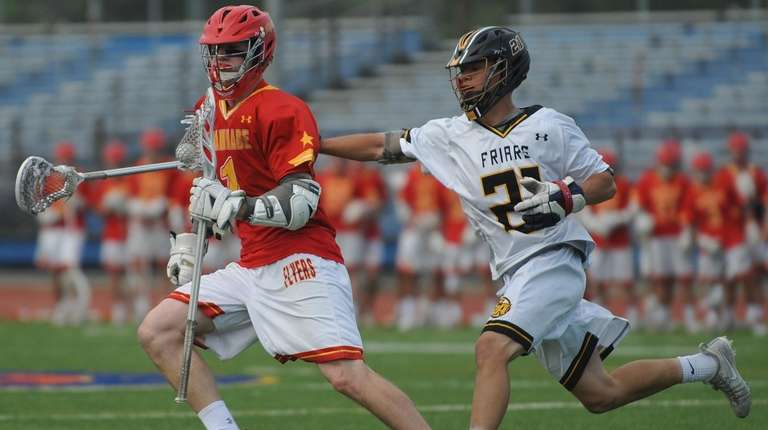 Aidan Byrnes of Chaminade, left, gets pressured by