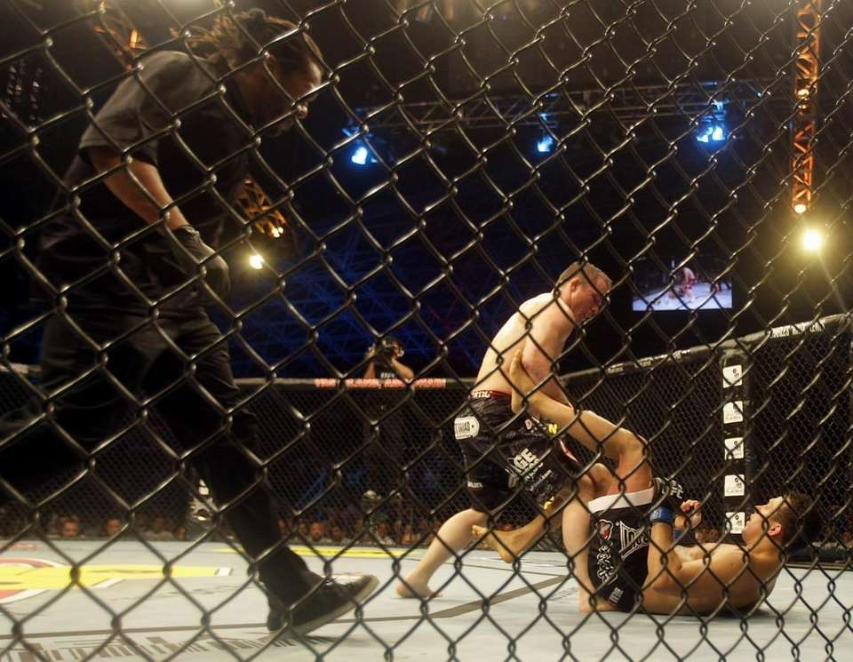 Matt Hughes, left, attacks Renzo Gracie during their