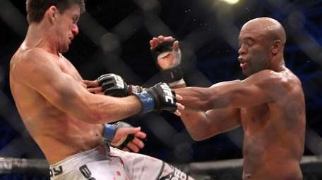 Anderson Silva, right, imposed his will over Demian