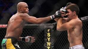 Anderson Silva, left, easily won a unanimous decision