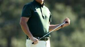 Phil Mickelson reacts to making bogey on the