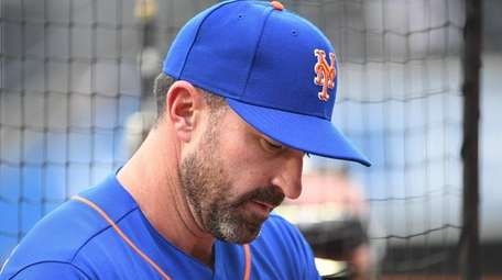 Mets manager Mickey Callaway looks on before a