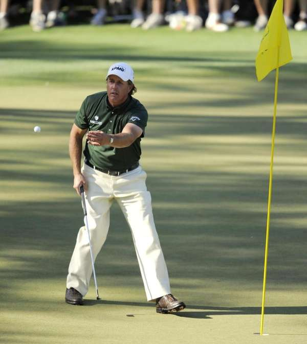 Phil Mickelson of the US plays the 15th