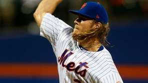 Mets pitcher Noah Syndergaard delivers against the Blue