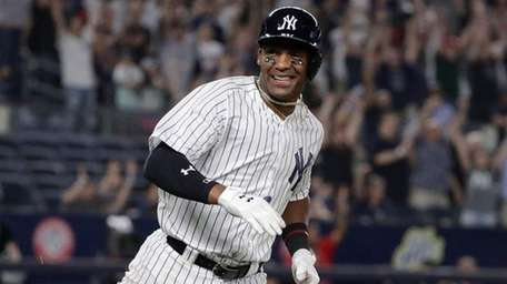 Yankees third baseman Miguel Andujar smiles after driving