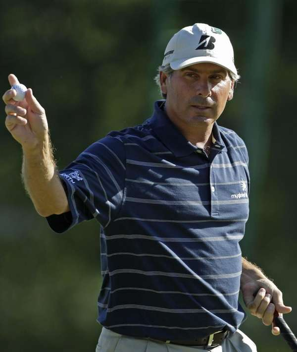 Fred Couples holds up his ball after a