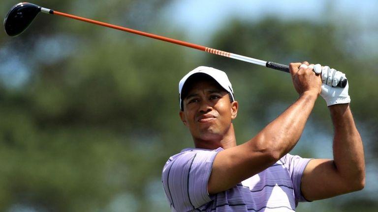 AUGUSTA, GA - APRIL 10: Tiger Woods hits