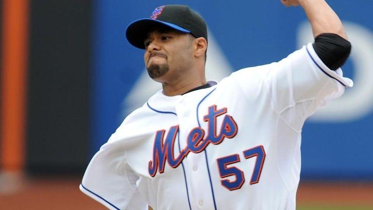 New York Mets' Johan Santana (57) pitches to