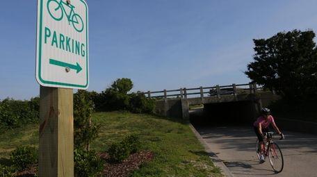 A bike rider heads out of an underpass