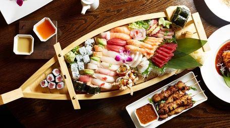 A medium sushi boat is served at Mango