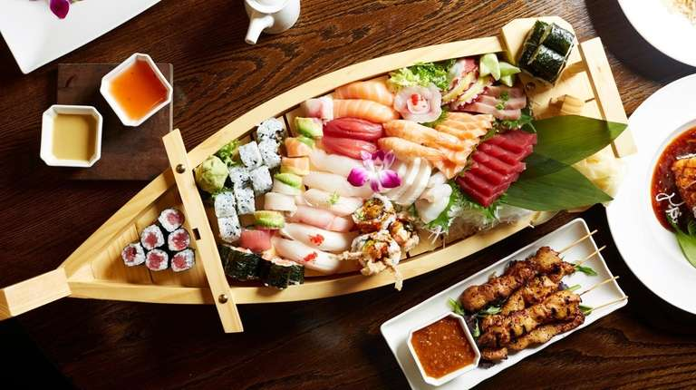 A medium sushi boat is served at Mango