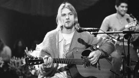 Nirvana frontman Kurt Cobain playing the guitar in