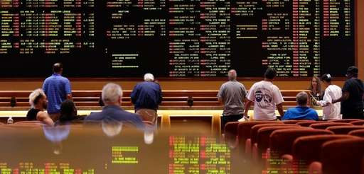 People line up on Monday to bet in