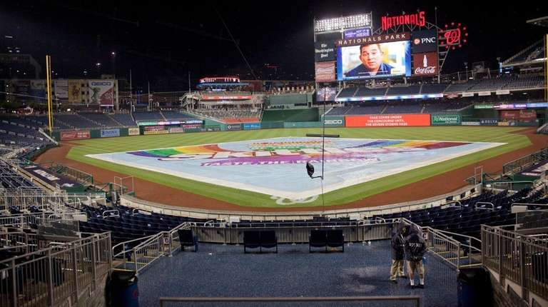 Tarp covers the infield during a rain delay
