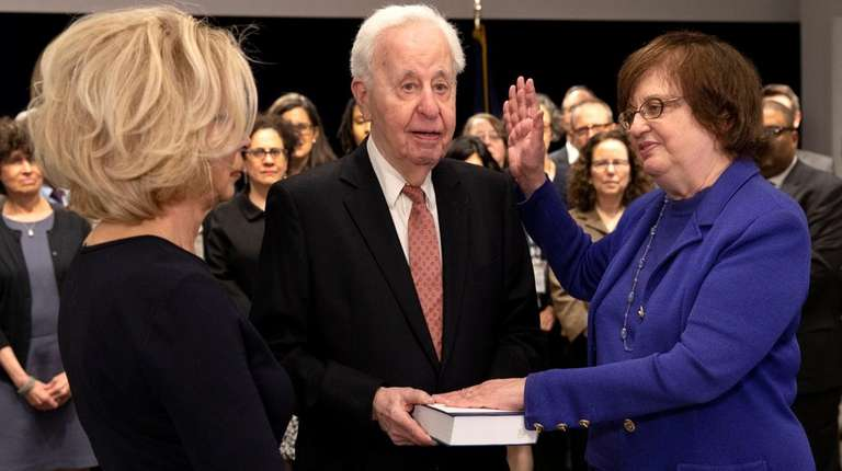 Barbara Underwood, right, takes the oath of office