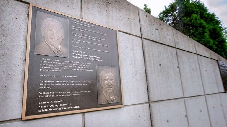 A plaque showing George W. Bush and Thomas