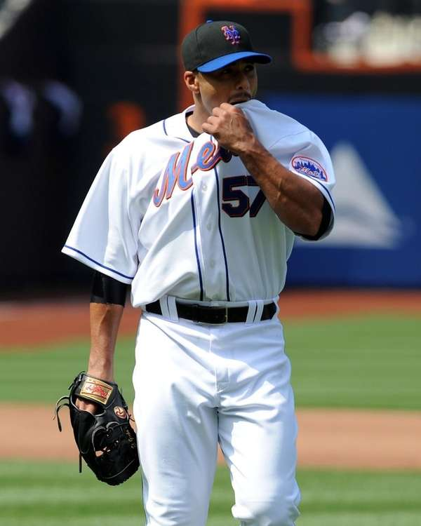 New York Mets' Johan Santana (57) wipes his