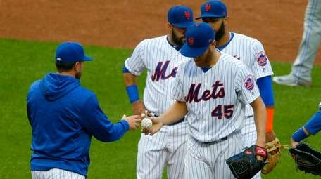 Zack Wheeler of the Mets hands the ball