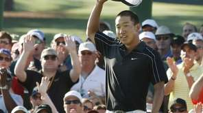 Anthony Kim saves his par on the 18th