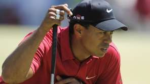 Tiger Woods lines a putt during the final