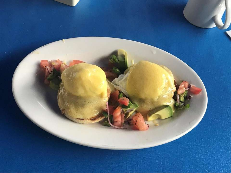 Crabby Benedict Poached eggs, hollandaise on top of