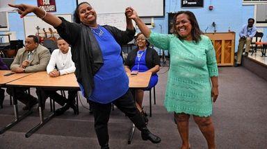 Carmen Ayala and Patricia Spleen celebrate their election