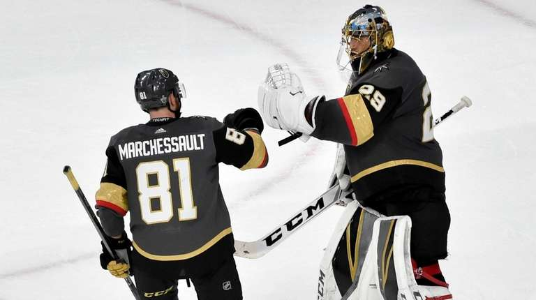 Golden Knights center Jonathan Marchessault celebrates with goaltender