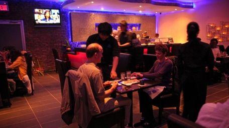 Diners enjoy Blue Fish, a new Japanese restaurant