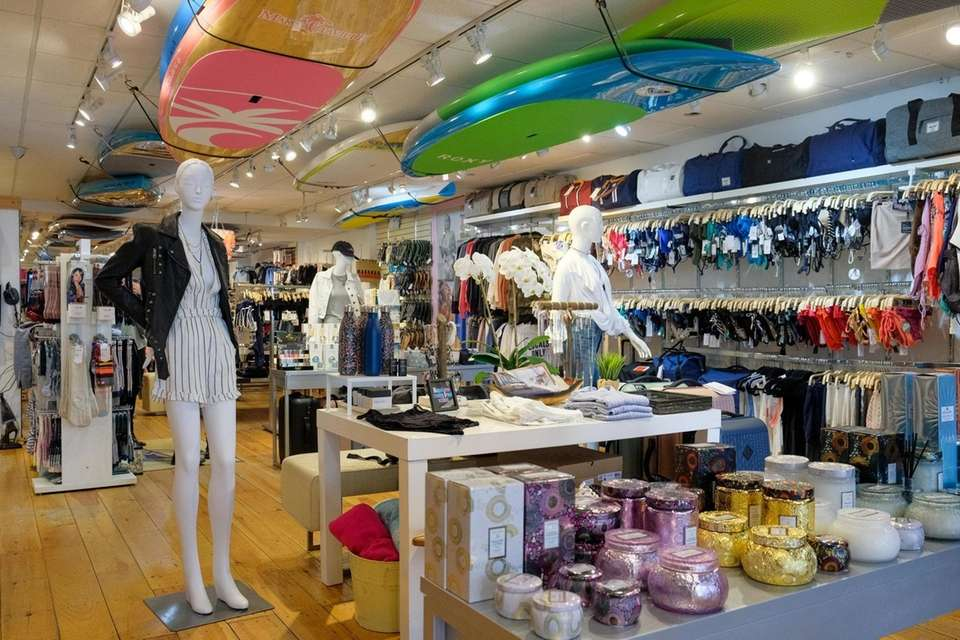 Surfboards, clothing and accessories are displayed inside of