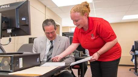 Amanda Crabtree of Andy Frain Services helps Chris